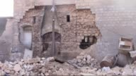 Almost all buildings collapsed following attacks of Syrian regime forces in Armanaz region of Idlib during 4 days and relatives of Syrians who are...