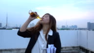 Alone young asian  businesswoman in depression, drinking alcohol