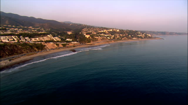 AERIAL Along Pacific Coast Highway on Santa Monica coast / California