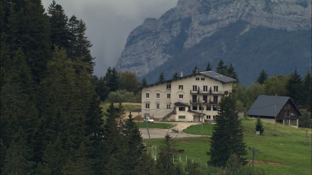 AERIAL WS Alpine ski lodge in late summer with Alps landscape / Rhone-Alpes, France