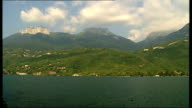 Police search for motives FRANCE HauteSavoie near Lake Annecy Chevaline EXT Picturesque scene of Lake Annecy with mountains in background Small boat...