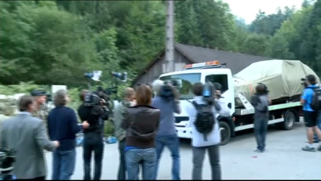 Police talk to seven year old survivor and reveal details of shooting FRANCE HauteSavoie near Lake Annecy Chevaline EXT Police truck along country...