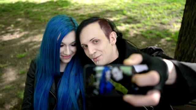 Alternative looking couple makes selfie