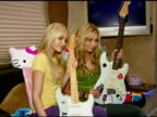 Aly and AJ Michalka receive their custommade Fender guitars at the Aly and AJ Presented with Custom Fender Guitars to KickOff Summer Tour at Verizon...