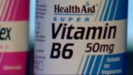 Alzheimer's Disease vitamin B tablets ENGLAND INT Various close shots of bottles of Vitamin B tablets including 'Vitamin B12' 'Vitamin B6' and 'B...