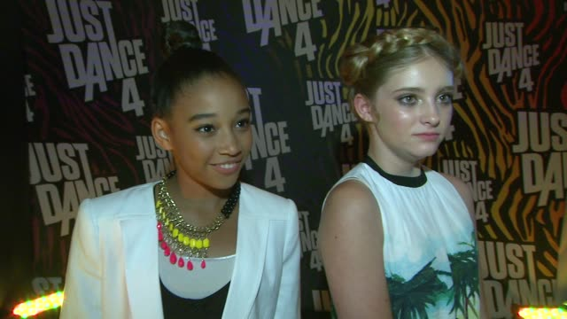 Amandla Stenberg Willow Shields on what they thought of the game Just Dance 4 how they liked the music in the game at Entertainment Weekly's 6th...