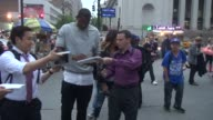 Amar'e Stoudemire signs for fans outside of Madison Square Garden for the Stanley Cup Championship in Celebrity Sightings in New York
