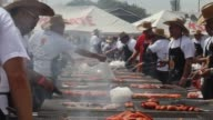 Amateur chefs took to their barbecue grills in Ciudad Juarez on Saturday to set a new Guinness World Record of the largest number of people cooking...