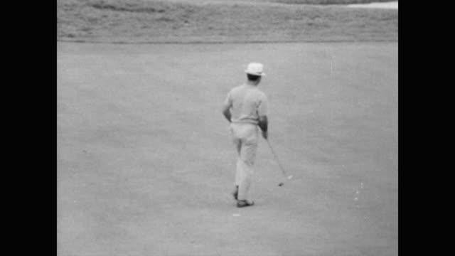 Amateur golfer Martin A Fleckman at US Open / Jack Nicklaus hits the golf ball high into the air / LS of golf course crown and players / CU Arnold...