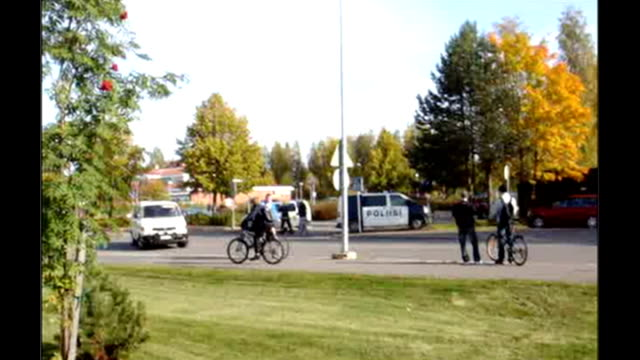 Amateur video showing police and emergency services following shooting * * ITN Kauhajoki EXT Footage Emergency vehicle arriving at school where...