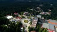 Amazing drone revealing shot of a ski resort mountain during summer