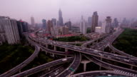Amazing Highway Intersection Shanghai with Skyline. Day to Night Timelapse.