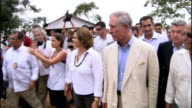 Prince Charles visit to Maguari Community BRAZIL Amazonas Tapajos National Forest EXT Brazilian police escort in boat / Prince Charles disembarking...
