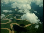 Amazon river meanders through rainforest, viewed through clouds