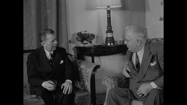 Ambassador Henry F Grady EXT American Embassy in Iran / US Ambassador to Iran Henry F Grady sitting in chair talking w/ others Hossenala sitting on...