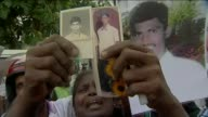 Ambassador to Brazil to face war crimes charges T15111324 / London Demonstrators holding pictures of relatives who were killed or disappeared during...