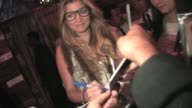 Amber Lancaster signs for fans at Just Dance 3 Launch Party in Los Angeles
