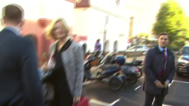 London EXT Amber Rudd MP speaking to reporter as into car SOT