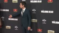 Amber Stevens and Andrew J West at 'The Walking Dead Season 5' Los Angeles Premiere at AMC Universal City Walk on October 02 2014 in Universal City...
