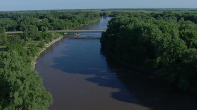 Ambulance driving across a bridge over a river