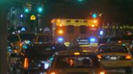 WS Ambulance driving down 9th Ave at night / New York City, USA