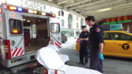 Ambulance emergency service and NYPD helping patient in New York City
