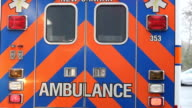 Ambulance from rear with lights