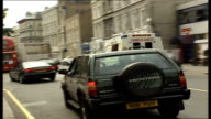 London MS ambulance at House of Commons MS Jenny Tonge behind ambulance Tracking shots ambulance siren on IV Jenny Tonge MP MS paramedic in ambulance...