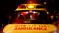 Ambulance with turned on siren at night