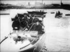 Amelia Earhart after flight others on motorboat in Southampton England / newsreel