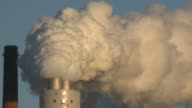 Ameren says some newly installed scrubbers cut sulfur dioxide emissions by 95 percent / various views of coal power plants pumping out steam and...