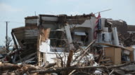 American Flag amidst Rubble and Destruction from Joplin Tornado