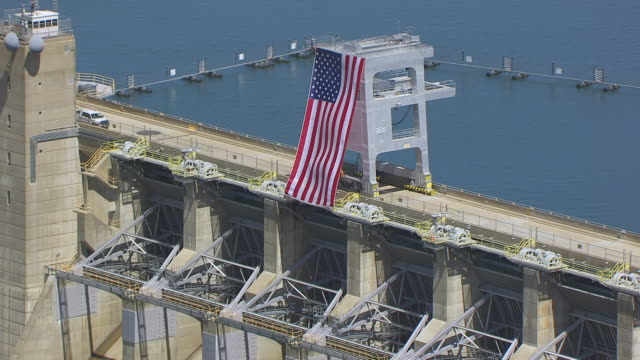 WS TU AERIAL POV American Flag on Folsom Dam of Northern California, California