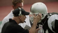 CU, PAN, American football coach yelling at players from sidelines, Staten Island, New York, USA