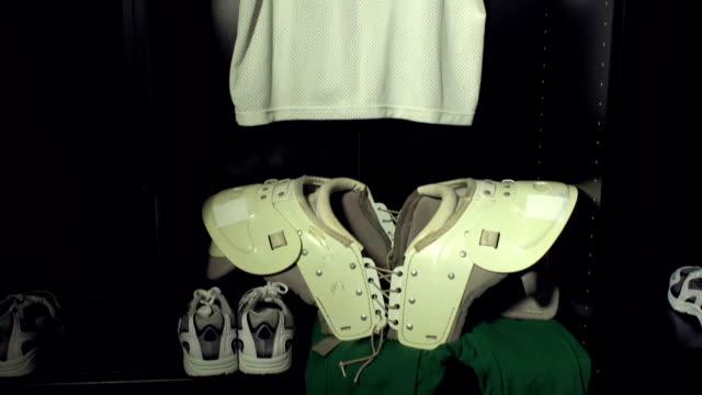 American Football Locker / Changing Room with pads & Helmet