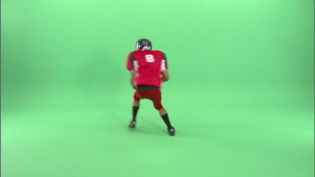 WS, American football player running in studio