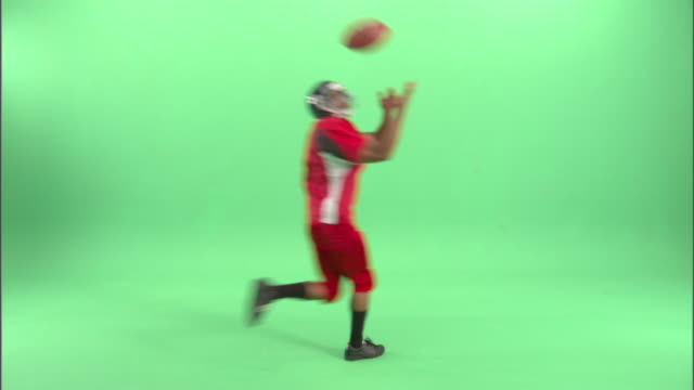 WS, American football player running in studio