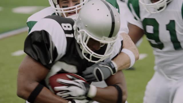SLO MO, CU, PAN, American football player running with ball, Staten Island, New York, USA