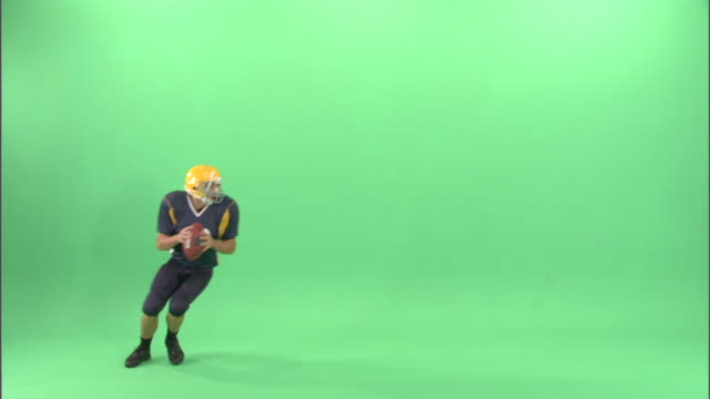 WS, American football player throwing ball in studio