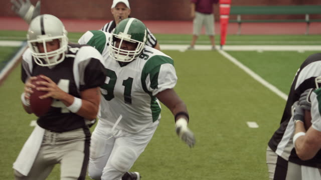 SLO MO, CU, PAN, American football players in action, Staten Island, New York, USA