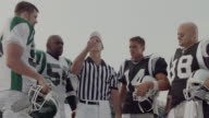 MS, American football referee tossing coin in field, Staten Island, New York, USA
