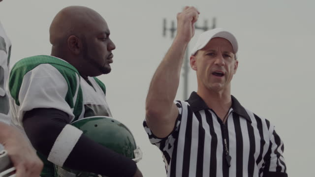 CU, American football referee tossing coin in field, Staten Island, New York, USA