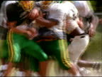 American footballers fall to ground in tackle during practice, Opelousas