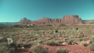 WS, American Indian woman riding horse in Red Desert, Utah, USA