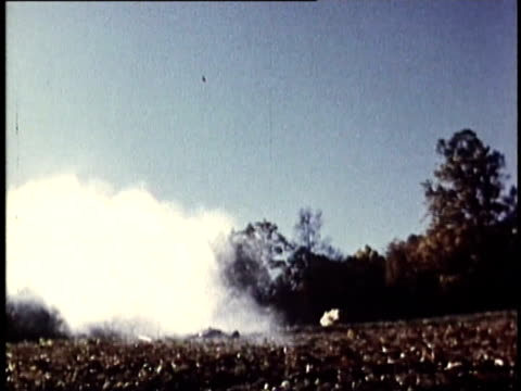 1969 REENACTMENT MONTAGE American revolutionary battle scene with close ups of cannon fire / United States