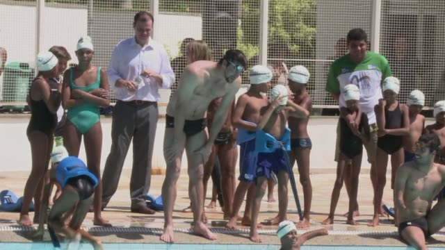 American swimming legend Michael Phelps the winner of 19 Olympic gold medals joined children from the Rocinha favela in the pool in Rio de Janeiro on...