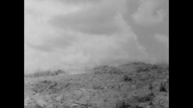 American troops firing into the jungle in Vietnam during the battle of Hill 881 / soldiers walking along the hill / shells barely missing Marines /...