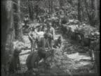 American troops preparing for battle in woods