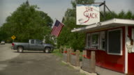 WS PAN Americana roadside snack bar with American flag / Stowe, Vermont, USA