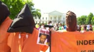 Amnesty International others join forces outside the White House to protest the continuing operation of the detention center at Guantanamo Bay Cuba...